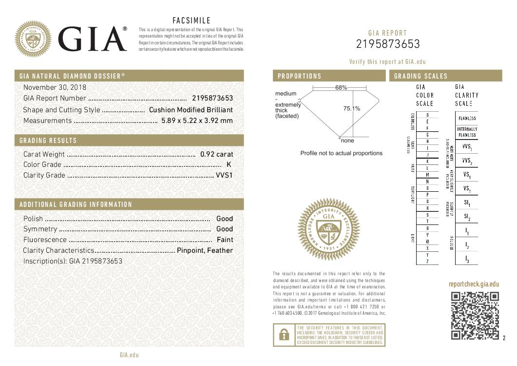 This is a 0.92 carat cushion shape, K color, VVS1 clarity natural diamond accompanied by a GIA grading report.
