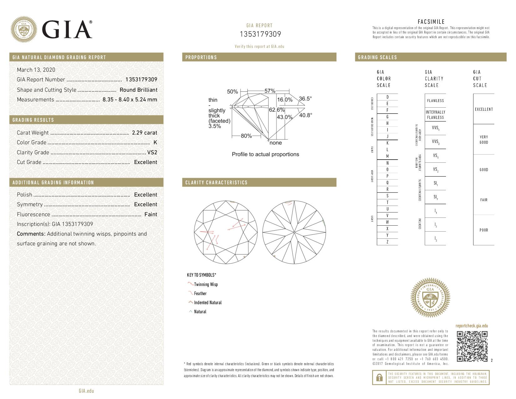 This is a 2.29 carat round shape, K color, VS2 clarity natural diamond accompanied by a GIA grading report.