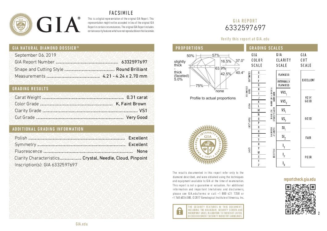This is a 0.31 carat round shape, K color, VS1 clarity natural diamond accompanied by a GIA grading report.