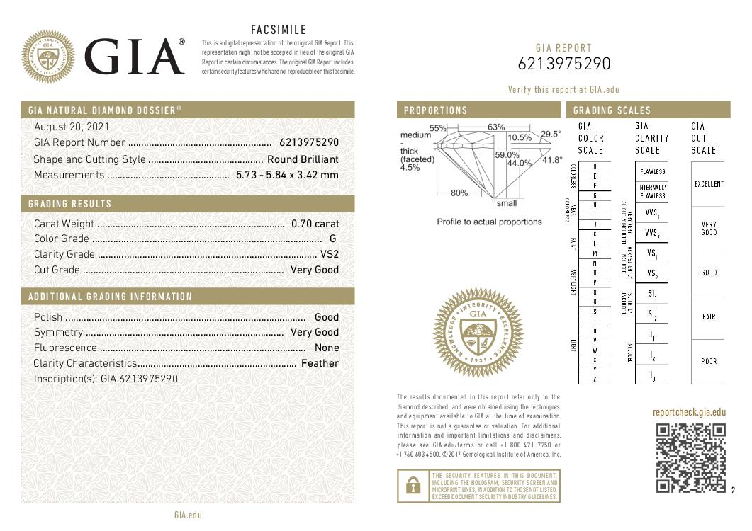 This is a 0.70 carat round shape, G color, VS2 clarity natural diamond accompanied by a GIA grading report.