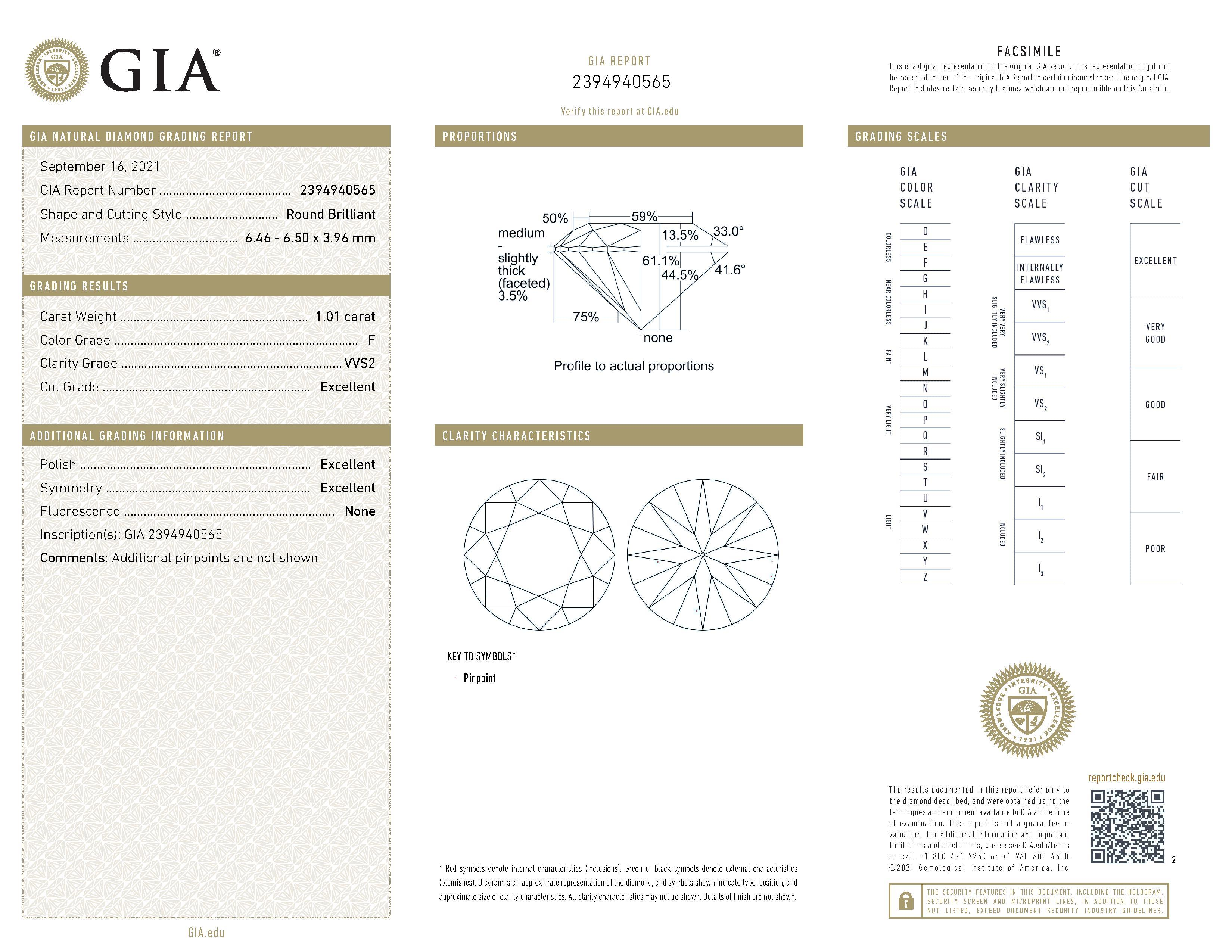 This is a 1.01 carat round shape, F color, VVS2 clarity natural diamond accompanied by a GIA grading report.