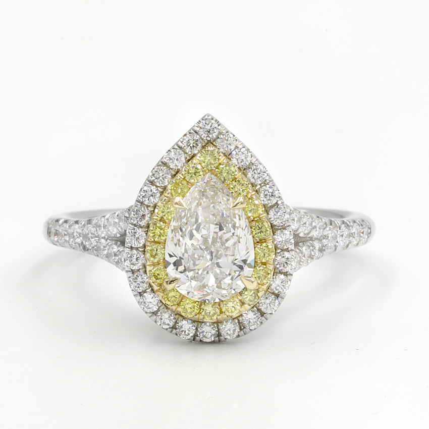 Shown with 0.96 ct. Pear H VVS1
